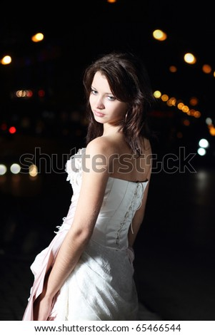 stock photo Beautiful bride in wedding dress in the night city