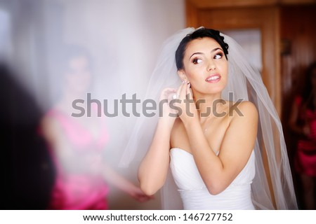 beautiful bride is getting ready
