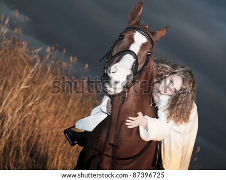 beautiful bride  on horse at evening in the field