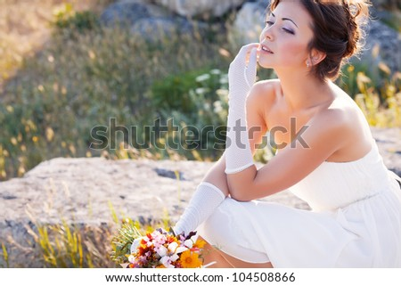 Beautiful bride outdoor portrait on the stone