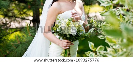 Beautiful bride outdoors in a park #1093275776