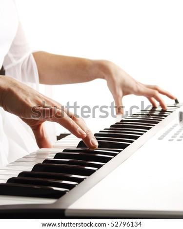 Beautiful bride playing piano