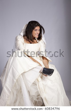 Beautiful bride ready to run away (grey background)