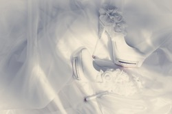 Beautiful bride shoes on a white foot.