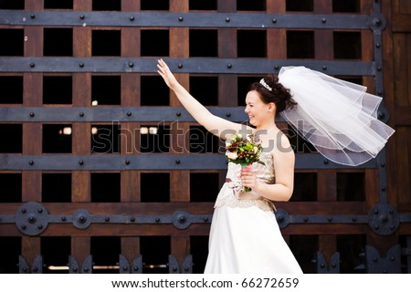 beautiful bride waving
