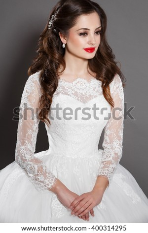 Beautiful Bride wedding makeup and hairstyle, vogue girl with long curly brown hair in white