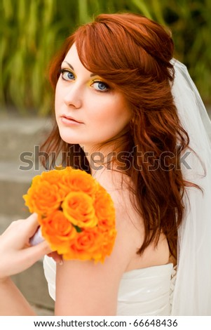 beautiful bride with a wedding bouquet