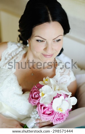 beautiful bride with a wedding bouquet of orchids