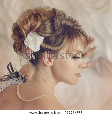 Beautiful bride with a wreath of roses. Updo. Wedding makeup. Instagram style.