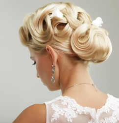 Beautiful bride with fashion wedding hairstyle - on white background