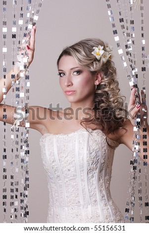 stock photo : beautiful bride with wedding hairstyle and flowers stock photo : beautiful bride with wedding hairstyle and flowers