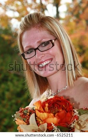 Beautiful bridesmaid in a fall wedding
