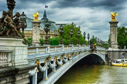 Beautiful bridge of Alexandre III in Paris at cloudy day