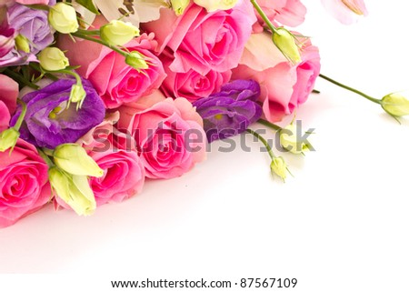 beautiful bright bouquet of roses, Lisianthus and other flowers on a white background