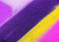 Beautiful bright colorful street art graffiti background. Abstract creative spray drawing fashion colors on the walls of the city. Urban Culture, yellow , pink , purple , crimson, blue texture