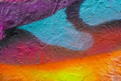 Beautiful bright colorful street art graffiti background. Abstract creative spray drawing fashion colors on the walls of the city. Urban Culture, pink , red , orange , yellow, crimson , purple texture