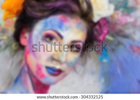 Beautiful, bright, creative makeup. blurred Background