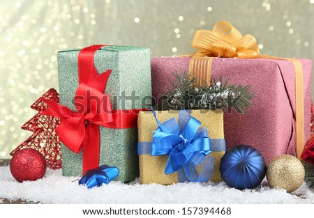Beautiful bright gifts and christmas decor, on shiny background