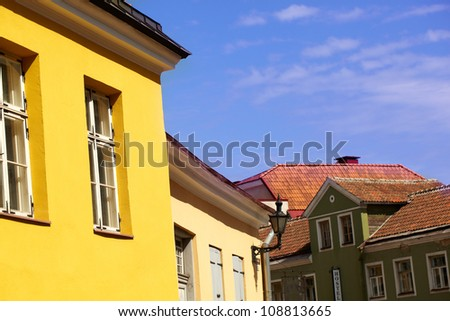 Beautiful bright vivid yellow and red roofs and blue sky in Tallinn, Estonia