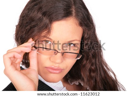 beautiful brown-haired woman looks above glasses