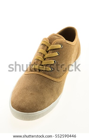Beautiful brown leather shoes for men isolated on white background #552590446