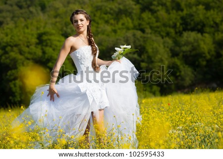 Beautiful brunette bride portrait in summer park
