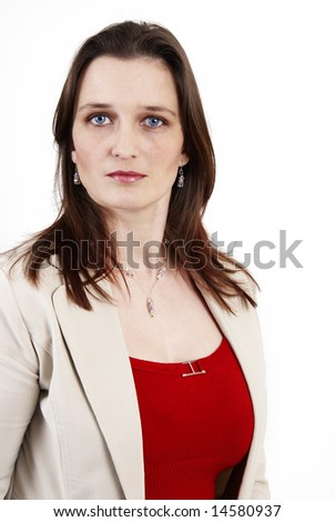 Beautiful brunette businesswoman wearing a beige jacket and a red top. Isolated on white background with copy space