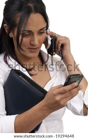 Beautiful brunette businesswoman wearing office clothes holding a couple of cellphones and keys in her hands. Isolated on white background with copy space