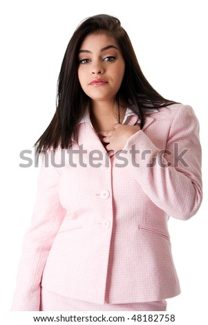 Beautiful brunette Caucasian Hispanic Latina successful confident career business woman standing, wearing pink suit and hand on chest, isolated.