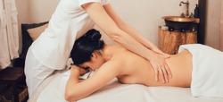 Beautiful brunette enjoying a Sabay massage in an oriental spa salon. Sabai massage is a combination of Thai traditional and Balinese massage