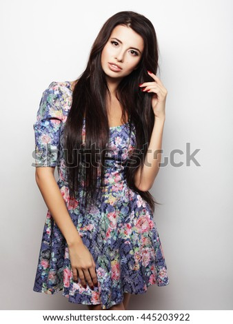 Beautiful brunette female in summer dress  #445203922