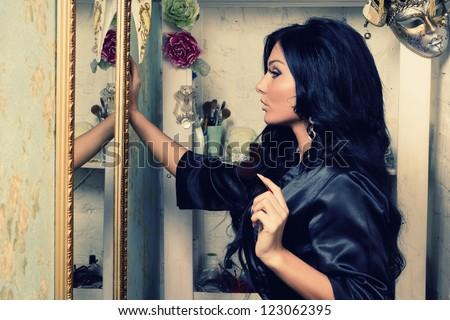 Beautiful brunette girl does make-up