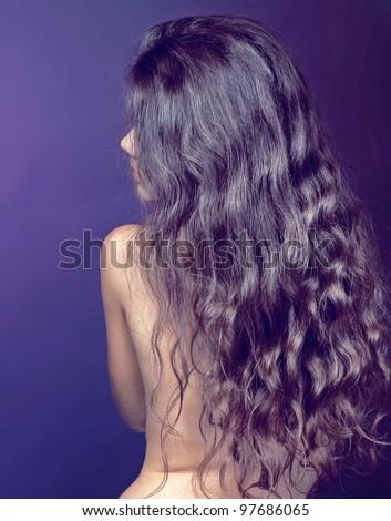 Beautiful Brunette Girl. Healthy Long Curly Hair