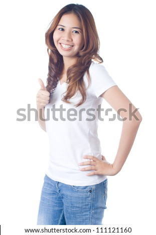 Beautiful brunette girl in jeans smiling and thump up on white background