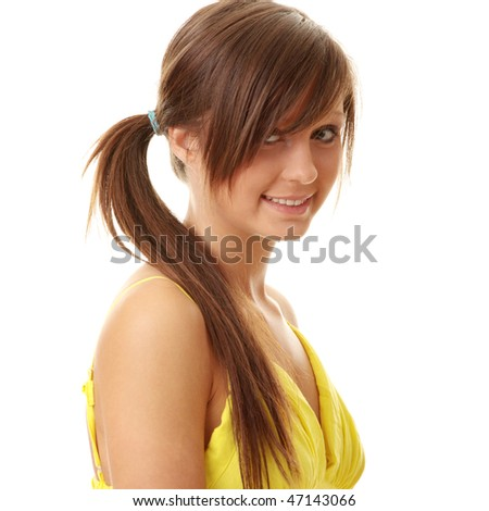 Beautiful brunette girl in yellow dress. Isolated on white background