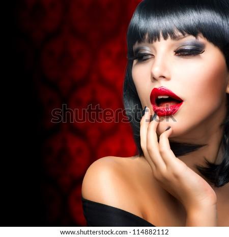 Beautiful Brunette Girl Portrait.Makeup. Sensual Red Lips and Smokey Eyes Make-up