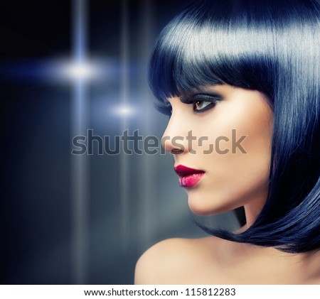 Beautiful Brunette Girl Portrait over Dark Background. Healthy Black Hair
