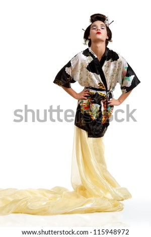 Beautiful brunette girl posing for Japanese dress on a white background isolated