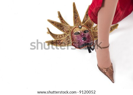 Beautiful brunette girl with Venice carnival mask.Sexy high hill shoe.