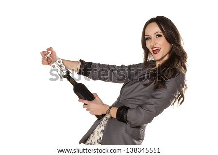 beautiful brunette having fun with a bottle of wine #138345551