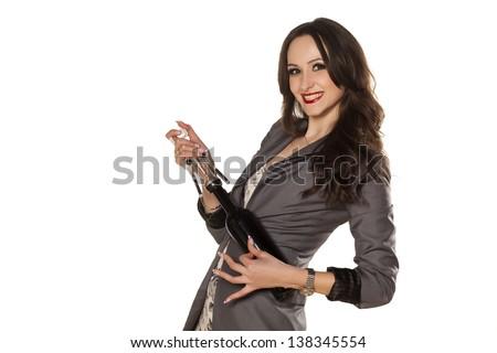 beautiful brunette having fun with a bottle of wine #138345554