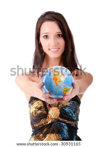Beautiful brunette holds globe in hands and laughs.