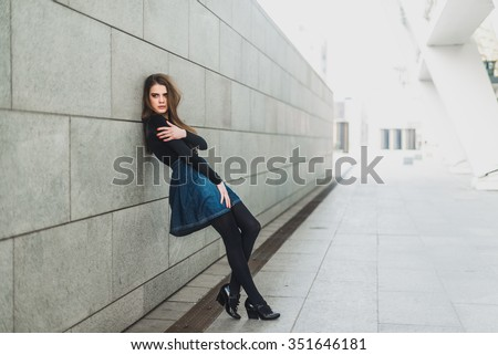 Stock Photo Beautiful brunette in a modern city