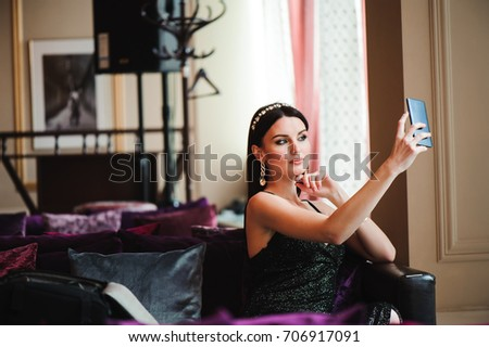Beautiful brunette in hotel with mobile phone #706917091