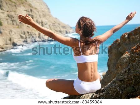 Beautiful brunette is happy on the beach
