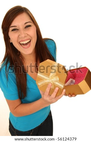 Beautiful brunette lady opening a gift box with surprise inside