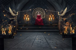 Beautiful brunette majestic woman in red luxuious dress sitting on throne in royal interior