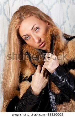 Beautiful brunette model in elegant fur coat