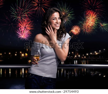 Beautiful brunette on a fireworks background