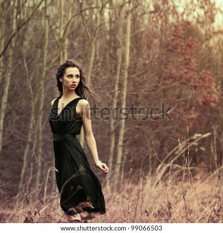beautiful brunette posing in...